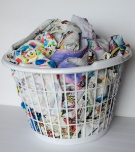 washed fabric in a bin
